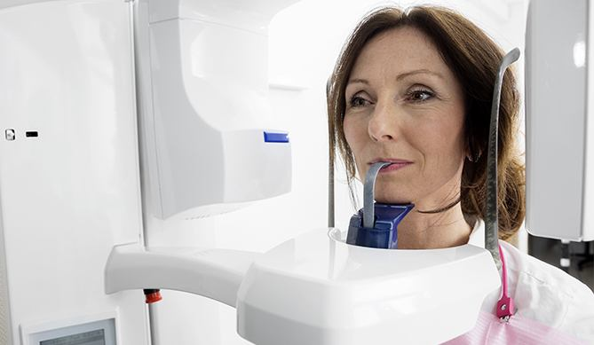 Woman receiving 3 D C T cone beam scan