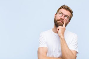 Man wondering about the cost of gum recontouring